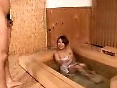 Attractive Asian bimbo enjoys taking a bath dressed only in