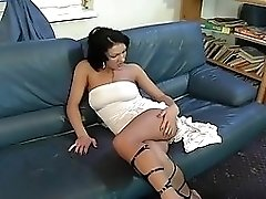 Short Haired Harlot Plays with Her Pussy
