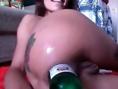 Boys and girls drink beer bottles hiding