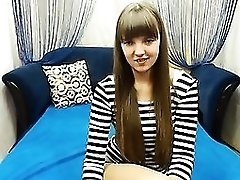 Cute chick in a striped blouse chats on live cam and shows