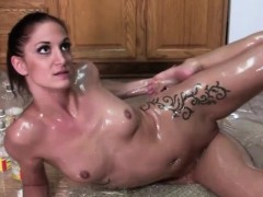 Brunette Emmy Pours Oil On Herself
