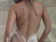 Asian beauty plays with pussy in the bathroom
